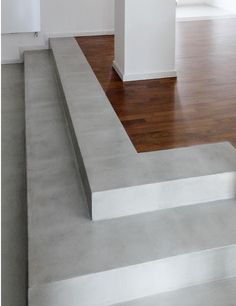Concrete stair and wooden floor