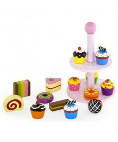 This Cake Stand comprises two tiers, each crammed with wooden tea time treats! There are cupcakes, sponge slices and biscuits among the goodies on offer - perfect for creating an exciting display. Encourages creative and imaginative role play. Made from high quality, responsibly sourced materials. Conforms to all current European safety standards.