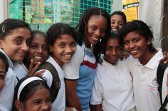 West Indies women cricket team captain, Merissa Aguilleira, pose for photo with children during the promotion of ICC Women World Cup at Star Sports SMAAASH, a interactive sport hub in Mumbai, India on February 6, 2013.