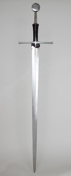 Hand and a Half Sword, 15th century. European. The Metropolitan Museum of Art, New York. Gift of William H. Riggs, 1913 (14.25.1196) | The name of this type of sword refers to the length of its hilt, which allows it to be wielded with one hand or two. #swords