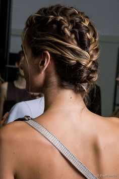 Triple French braided updo hairstyle.