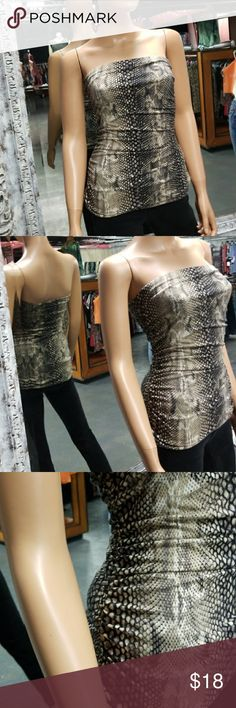 💋EXPRESS Snakeskin Python Ruched Tube Top Satin lined and exquisite on. Ruched sides for the ultimate look. WOW  Why SHOP MY Closet? 💋Most NWT or Worn Once 💋Smoke/ Pet Free 💋OVER 750 🌟🌟🌟🌟🌟RATINGS & RISING! 💋TOP 10% Seller  💋TOP RATED 💋 FAST SHIPPER  💋BUNDLES 20% OFF 💋EARN VIP $$$- SPEND ANYTIME  💋QUESTIONS?? PLEASE ASK! ❤HAPPY POSHING!!! 💕 Express Tops Tank Tops
