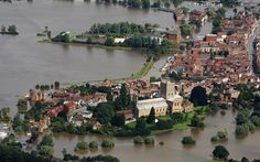 The town of Tewkesbury is submerged in receding flood waters of the River Severn and Avon