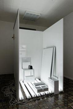 Laura Lamiel - Figure IV, 2012 - Diverse elements: chairs, neon tubes, rubber, brick, enameled silkscreened steel