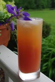Wiki Waki Woo    1/2 ounce vodka   1 1/2 ounces rum   1/2 ounce tequila   1/2 ounce triple sec   1 ounce Amaretto   1 ounce orange juice   2 ounces pineapple juice   1 ounce cranberry juice   1 cherry   Directions:  1  Combine ingredients with ice, pour over ice in a tall glass. Garnish with cherry or pineapple slice. and hang on to your hat.