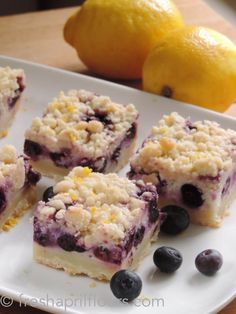 Blueberry Lemon Pie Bars: creamy blueberry filling sitting on top of a buttery shortbread crust-- YUMMM.