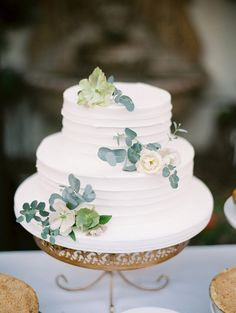 wedding cake with eucalyptus - photo by Mallory Dawn Photography http://ruffledblog.com/high-school-sweetheart-wedding-in-california