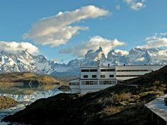Located in the heart of Torres del Paine National Park, rooms at the all-inclusive Explora lodge overlook glittering Lake Pehoé and open up to vistas of the Cordillera del Paine mountain ridge. There are plenty of diversions to keep you busy, like guided rainforest hikes and horseback riding (there are more than 50 day trips to choose from). But nobody will judge you if you decide to spend all your time just hanging out in one of four open-air jacuzzis, soaking in the incredible views with a…