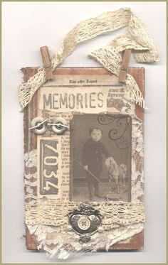 altered book cover; like the idea of clothespins to attach the hanger