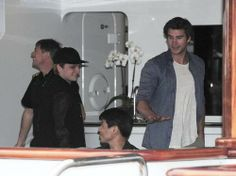 Josh Hutcherson and Liam Hemsworth on a yacht in Cannes on May 17, 2014.