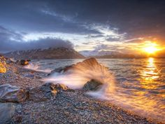 Photograph by Christopher Zimmer. Water from the Bering Sea crashes on the rocks of Margaret Bay in Dutch Harbor, Alaska.