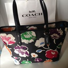 """Lg NWT Coach Wildflower Zip Tote/Black Absolutely beautiful NWT  Coach large Wildflower City Tote/black PVC coated leather handbag.   Trimmed in black leather with silver hardware. Zip top closure. Easy care rainbow colored flowers with black twill lining inside, zippered pocket and two slip pockets. Handles with 9 1/2"""" drop. Light weight.  No Trades Coach Bags Shoulder Bags"""