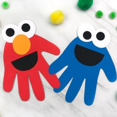 This handprint Elmo and Cookie Monster craft is a perfect activity for a Sesame Street birthday party! It's a simple DIY craft that comes with a free printable template to make it even easier! for toddlers Handprint Cookie Monster & Elmo Craft For Kids Toddler Arts And Crafts, Baby Crafts, Crafts For Preschoolers, Arts And Crafts For Kids Toddlers, Hand Crafts For Kids, Disney Crafts For Kids, Daycare Crafts, Preschool Crafts, Easy Diy Crafts