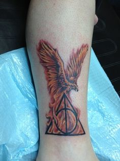 Phoenix and the Deathly Hallows Tattoo. LOVE LOVE LOVE