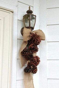 Burlap ribbon and pine cones wired together