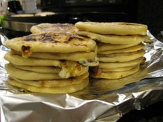 Pupusas de Cerdo Con Queso (El Salvador).  Pork Pupusas with Cheese.  (Recipe in Spanish.  You can use Google translate.)