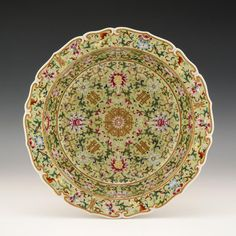 A truly magnificent charger with a gently barbed and scalloped edge in a famille rose palette on a Jiaqing green grou. on Apr 2018 Rose Bowl, Ancient China, Scalloped Edge, Metal Working, Wedding Gifts, Oriental, Decorative Plates, Auction, Pottery