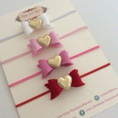 Beautiful handmade bow. Made with 100% wool felt and a gold padded heart. Measures approx 5.5cm The bow can be attached to any of the following (see photos):  A crocodile clip lined with ribbon  A 15mm regular band with gold foil 'love' writing.  A thin 3mm band This is not a