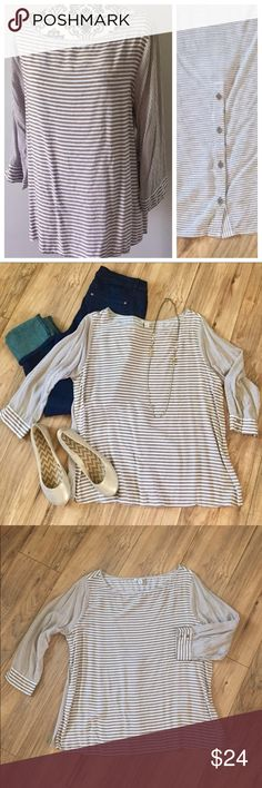 Tan & white striped 3/4 sleeve button back blouse This 3/4 sleeve blouse is sweet and feminine with button back detail and boat neck. Tan and white stripes are larger on the front and smaller on the back and sleeves. 100% rayon is machine washable. Worn once - EUC! Cato Tops Blouses