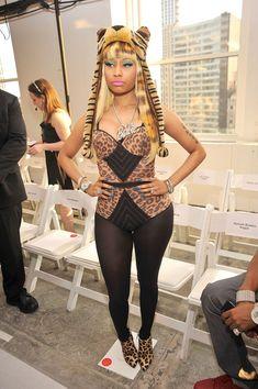 Nicki Minaj showed her love for Barbie with a large pendant necklace at the Oscar de la Renta spring 2012 fashion show.