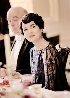 Lady Cora with long pearl and filigree necklace and drop earrings.  Charming as always!