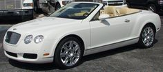 all white bentley convertible,  I'd love to drive it for a day