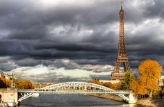 Eiffel Tower under a rainy sky from Grenelle bridge in fall