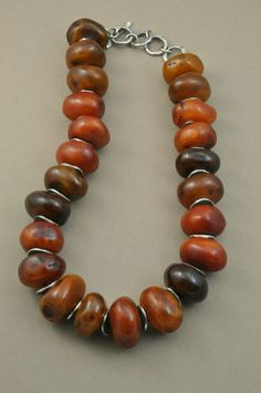 Old Tibetan Amber combined with sterling silver spacers | by Holly Masterson.