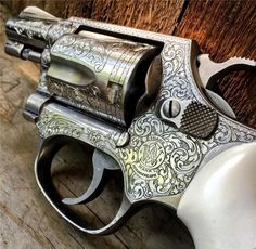 "Smith & Wesson Engraved Model 60 .38 special stainless steel finish 2"" barrel full coverage engraving and engraved for two different styles of stocks."
