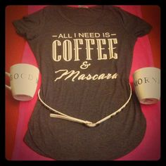 """HP 5/19 All I Need Is Coffee & Mascara Tee Best in Tops Party HP 5/19/16 NWOT! Hip & Trendy! Charcoal Grey with White Graphics on the Front. Scoop Neck. Tunic Length. Shirttail Hem. Stylish High Slits on both sides. The Center of this Tee from Top to Bottom is about 28"""" so looks good loose or with a Skinny Belt. 95% Rayon/5% Spandex. Brand New. Excellent Condition. Made in USA. No Trades. Love this top, but Tea ☕️ is my fav drink. Otherwise, I would save this Beautiful Tee for myself...for…"""
