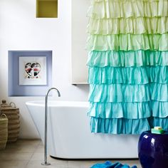 An all-white bathroom scheme is practical and won't date, but the problem is it can often look dull and unloved. Bring the passion back with a statement shower curtain. This great frill design combines myriad blues, greens and teals and really packs a punch.