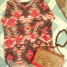 NWOT Aztec print top ❤️ Brand new without tags! This adorable top has Aztec print design in red, orange, tan, white and black. It's a quarter sleeve and is light weight. Almost Famous Tops Blouses