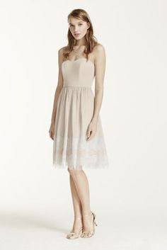 Stylish, fun and chic, your wedding party will stand out in this beautifulcrinkle chiffon dress!  Straplessbodice with sweetheart neckline and figure flattering natural waist.  Contrast lace bands add texture and a unique feminine detail to the hemline.  Fully lined. Back zip. Imported polyester. Dry clean only. Available in Extra Length sizes as Style 2XLF16004.