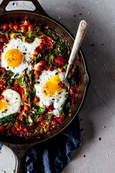 Bold Mediterranean flavors turn a simple shakshuka into something new and exciting when you whip up this harissa baked eggs recipe! With rich aromatics, savory chickpeas, spicy harissa and pepper flakes, this dish packs enormous flavor in mere minutes in a single skillet and is perfect for breakfast or dinner! From Minneapolis Food Blogger Karly Gomez | asimplepantry.com Chickpeas Spinach Recipe, Canned Chickpeas, Minneapolis Food, Mediterranean Spices, Mediterranean Breakfast, Breakfast Burger, Egg Recipes, Dinner Recipes, Brunch Recipes