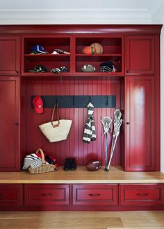 Your essential guide to mudrooms: What is a mudroom? What is a mudroom used for? What are the essential components of a mudroom? And 7 mudroom design ideas. Best Kitchen Cabinet Paint, Black Kitchen Cabinets, Custom Kitchen Cabinets, Red Kitchen, Painting Kitchen Cabinets, Red Cabinets, Red Laundry Rooms, Kraftmaid Cabinets, Better Homes And Gardens