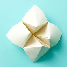 Learn how to make a cootie catcher with a sheet of paper and a few simple folds.