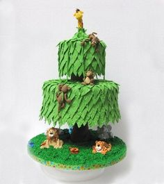 jungle tree - Whimsical jungle cake I made for the Pearland Day of Sharing that is on May 16th. Fondant figures, leaves and tree trunk. The trunk is actually a cake stand that I covered. Grass is royal icing. Thanks for looking! :)