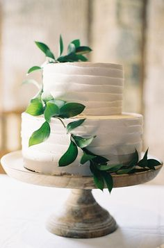wedding cake with greenery - photo by Feather and Stone http://ruffledblog.com/classic-southern-wedding
