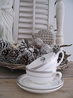 Winter tea cups in my favorite colors . Silver and white are so lovely.