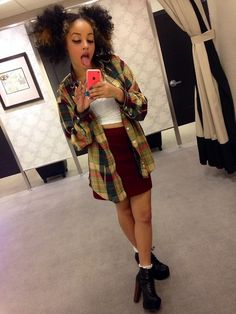 Will def recreate this outfit from head to toe. White tank, with burgundy skirt, with open green flannel with cherry red dr martens with flirty socks