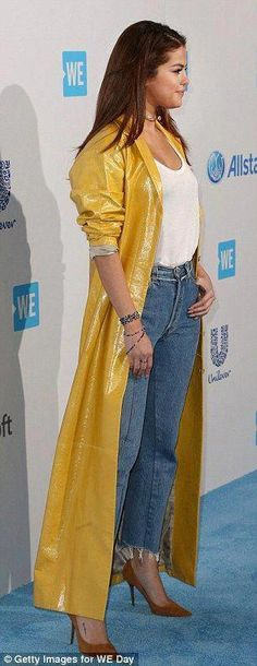 Selena Gomez stands out in bold yellow raincoat at WE Day California event in LA before sizzling performance on stage Black Rain Jacket, North Face Rain Jacket, Rain Jacket Women, Green Raincoat, Raincoat Jacket, Hooded Raincoat, Pvc Raincoat, Raincoats For Women, Jackets For Women