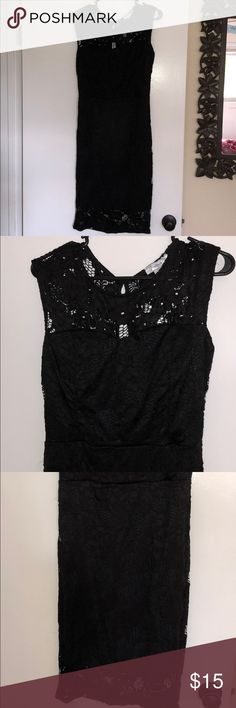 Black lace fitted dress Never worn. I bought this dress for a wedding and ended up wearing a different one instead. No flaws. It is really beautiful and fits great to show off your assets. Material is stretchy. jasmine Dresses