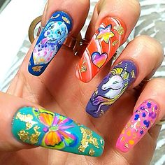 Clients view of LISA FRANK nails! All *hand painted* nail art. To make an appointment call  @neihulesalon 213.627.5300  #lisafrank #lisafranknails #rainbow #rainbownails #neonnails #youngnails #handpainted #art #nails #nailart #nailartdesigns #gelnails #gelmani #gelnailart #nailsmagazine #nailitmag #nailstagram #nailsofinstagram #nails2inspire #nailswag #sweetbcreations #neihulesalon #neihulenailsalon #la #losangeles #downtownla dtla