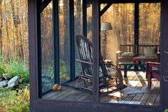 Screened porch in the woods.