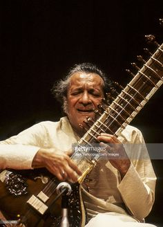 Indian musician Ravi Shankar (1920 - 2012) plays sitar during a performance at a World Music Institute concert in Alice Tully Hall at Lincoln Center, New York, New York, May 16, 1990.