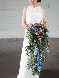 For the spontaneous and daring Aries bride, a cascading wedding bouquet filled with unique blooms, like thistle, is the ideal choice for this zodiac sign.