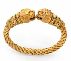 A RARE YELLOW GOLD AND ENAMEL LION BRACELET, BY FABERGE