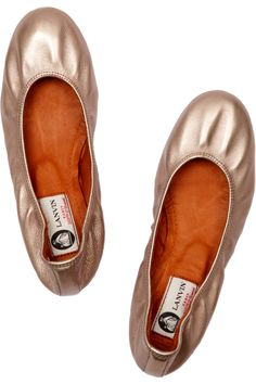 Lanvin metallic ballet flats with a concealed 1 inch heel.  Ballet flats are the one shoe I never pay much for, but I love secret heels.