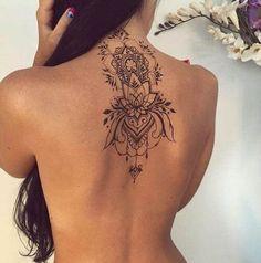 latest modern mehndi design on women's back