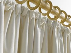 Gathered / cottage heading - A traditional heading, gathered pleats  look cosy and unpretentious. They also require the least amount of fabric of all the heading types making them very economical. Gathered pleats are suitable for both tracks and poles.